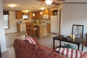 Photo Of Double Wide Home 304 Stock Model Furnished Living Area Looking Into Kitchen