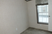 Photo Of 306 Stock Model Single-Wide Home Unfurnished Bedroom With Large Window