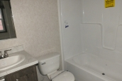 Photo Of 306 Stock Model Single-Wide Home Bathroom Shower And Toilet
