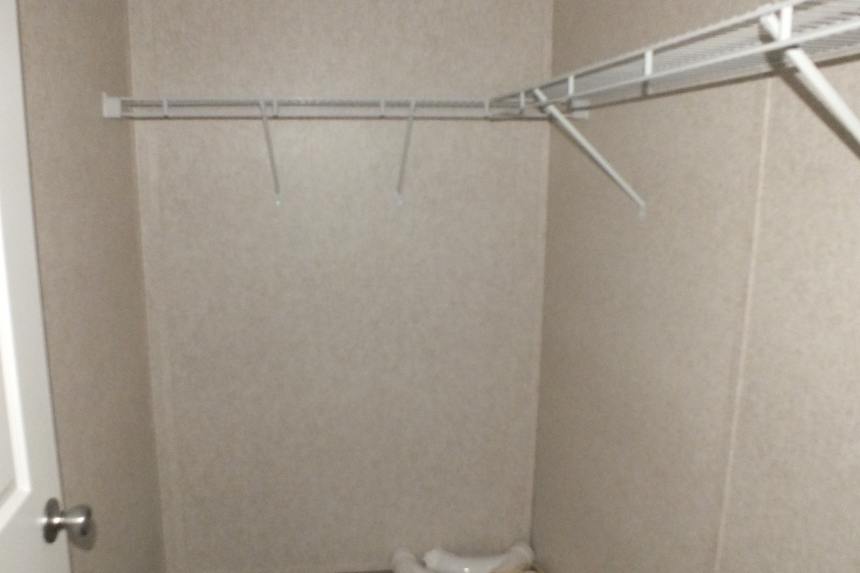 Photo Of 306 Stock Model Single-Wide Home Closet Interior With Wire Shelving