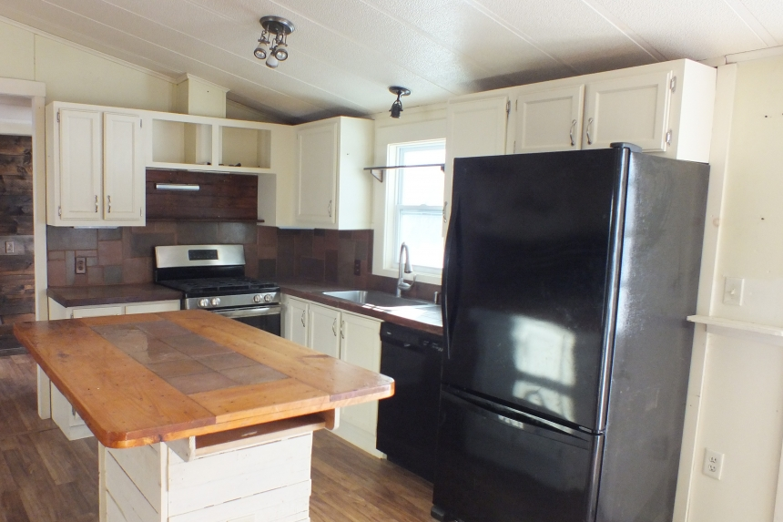 Photo Of Double Wide Home 1987 Pine Grove Kitchen With Black Appliances And Island