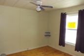 Photo Of Double Wide Home 1987 Pine Grove Empty Bedroom With Bright Window And Ceiling Fan.