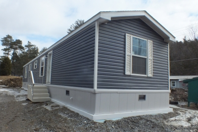 A Photo Of 141 Milton Vermont Single Wide Home Gray Exterior