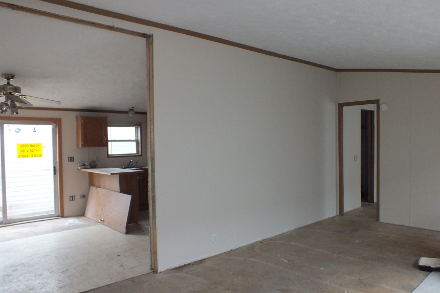 Photo Of Double Wide 2000 Dutch Unfurnished Living Area With White Walls