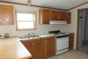 Photo Of Double Wide Home 2000 Dutch Kitchen With Sink Stove And Bright Window