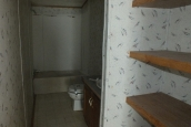 Photo Of Double Wide Home 2000 Dutch Closet With Wood Shelves Looking Into Bathroom