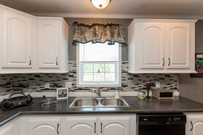 A photo of a kitchen in a double wide home in Vermont.