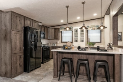 A photo of the kitchen inside of a double-wide manufactured home.