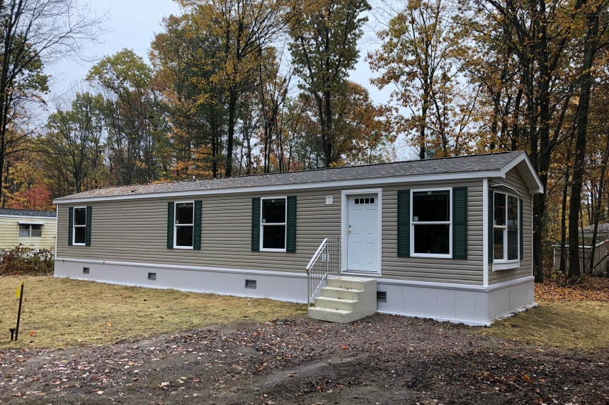 A Photo Of Single Wide Home In Colchester Vermont Tan Exterior