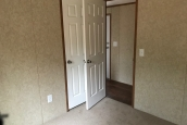 A Photo Of Single Wide Home In Colchester Vermont Unfurnished Bedroom With Door Opening To Hallway