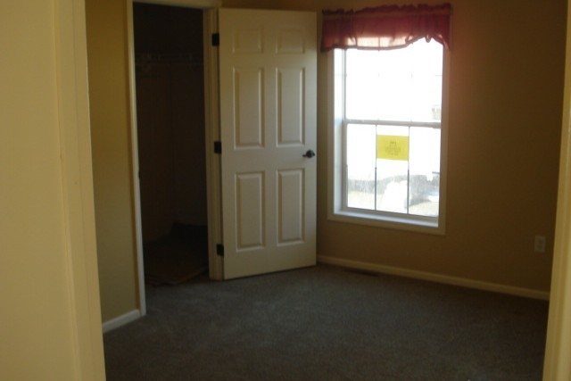 Photo Of Double Wide Home 5228-405-1 Unfurnished Bedroom With Closet And Bright Window
