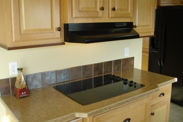 Photo Of Double Wide Home 5228-405-1 Black Kitchen Range And Hood With Wood Cabinets