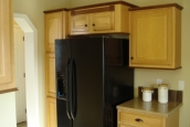 Photo Of Double Wide Home 5228-405-1 Black Refrigerator And Wood Cabinets
