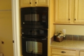 Photo Of Double Wide Home 5228-405-1 Black Oven And Wood Cabinets