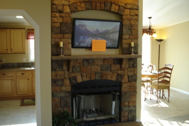 Photo Of Double Wide Home 5228-405-1 Fireplace With View Into Bright Dining Area And Kitchen