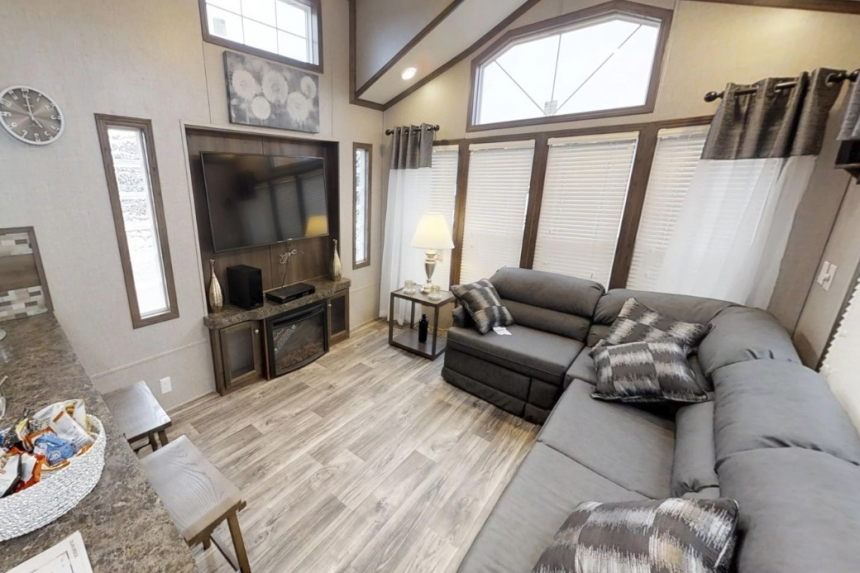 A Photo Of Featured Park Model 39Ukl Furnished Living Area With Gray Couches