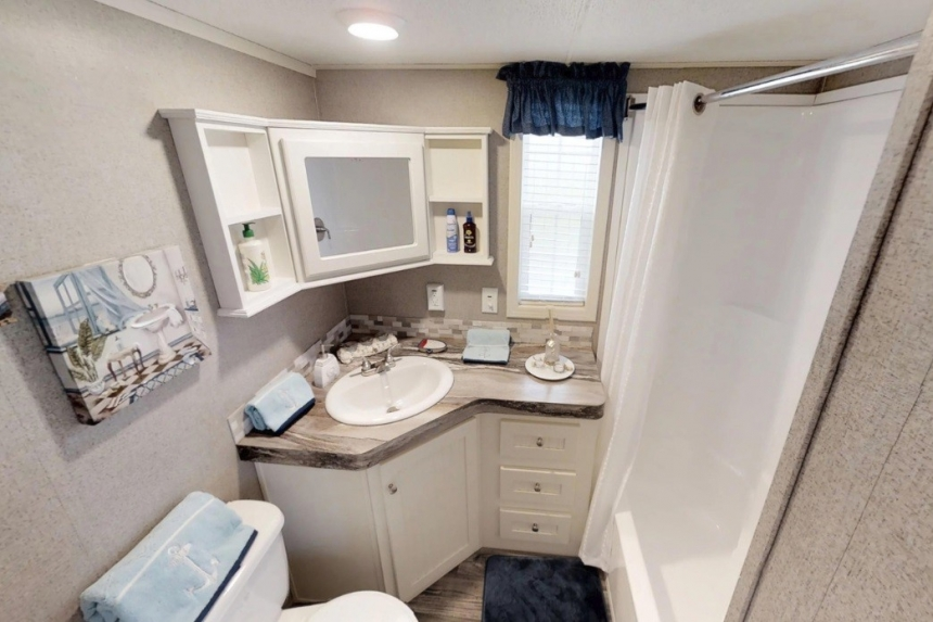 A Photo Of Park Model 40Flk White Bathroom Vanity And Shower