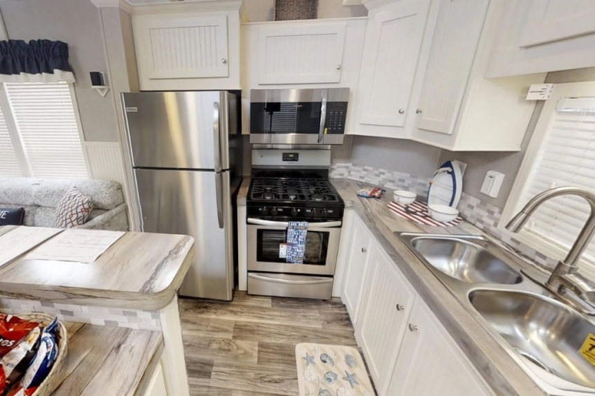 A Photo Of Park Model 40Flk Kitchen With White Cabinets And Appliances
