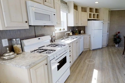 Photo Of Single Wide Home 8016-721 Kitchen With Appliances And Wood Cabinets