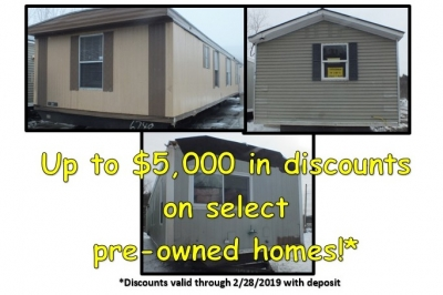 A photo of three single-wide manufactured homes with an advertisement for reduced prices.