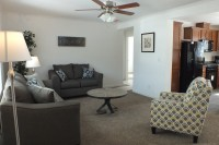 A photo of a living room interior of a manufactured home sold by Fecteau Homes.